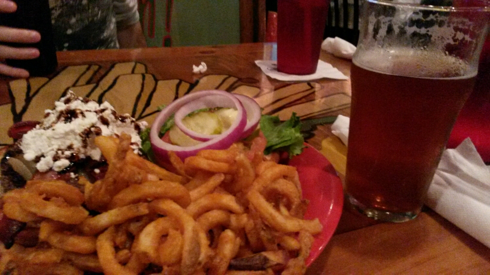 Burger, curly fries, and beer