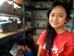 "One of Bulir Padi's sponsored students. Utlul Aini, SMK Wiyata Satya. Her father works as a rujak street hawker and her mother gets additional income for the family by being a part-time nanny. Utlul understands how important it is that her parents receive help to finance her education. ""I feel my parents are really helped from the support we receive from Bulir Padi's scholarship fund because my parents also have to pay for my younger sister's education,"" Utlul says."