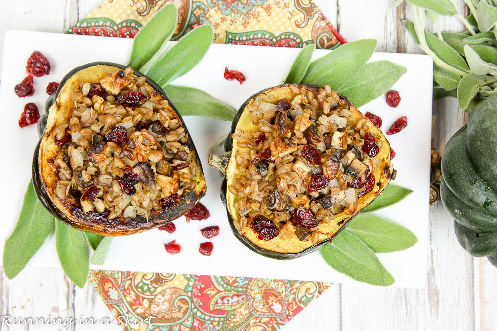 Stuffed acorn squash plated with fresh sage on a white plate.