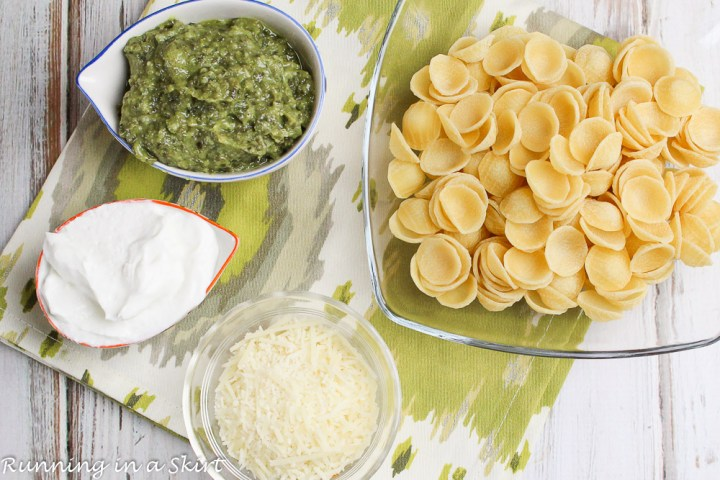 Ingredients laid out for healthy pesto pasta.