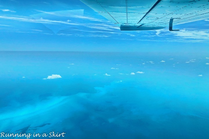 Flying over the blue water of the Bahamas.