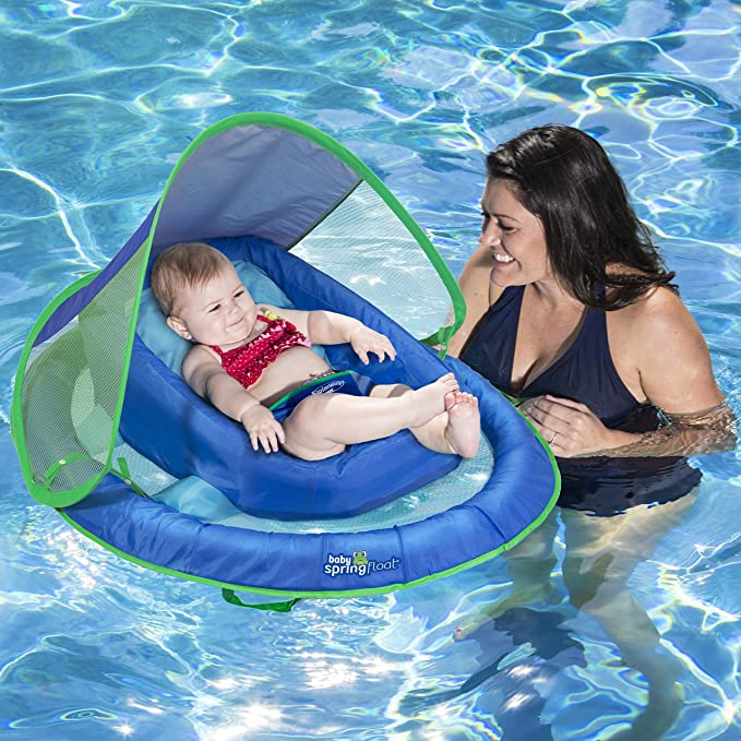 Mom holding baby in Infant Spring Float