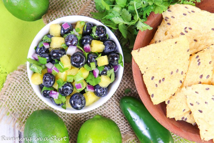 Overhead shot of Blueberry Salsa and chips in a wooden bowl.