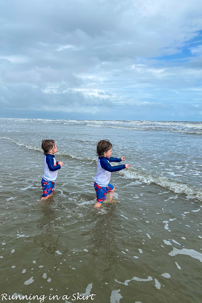 Toddlers running into water on beach Kiawah Island South Carolina