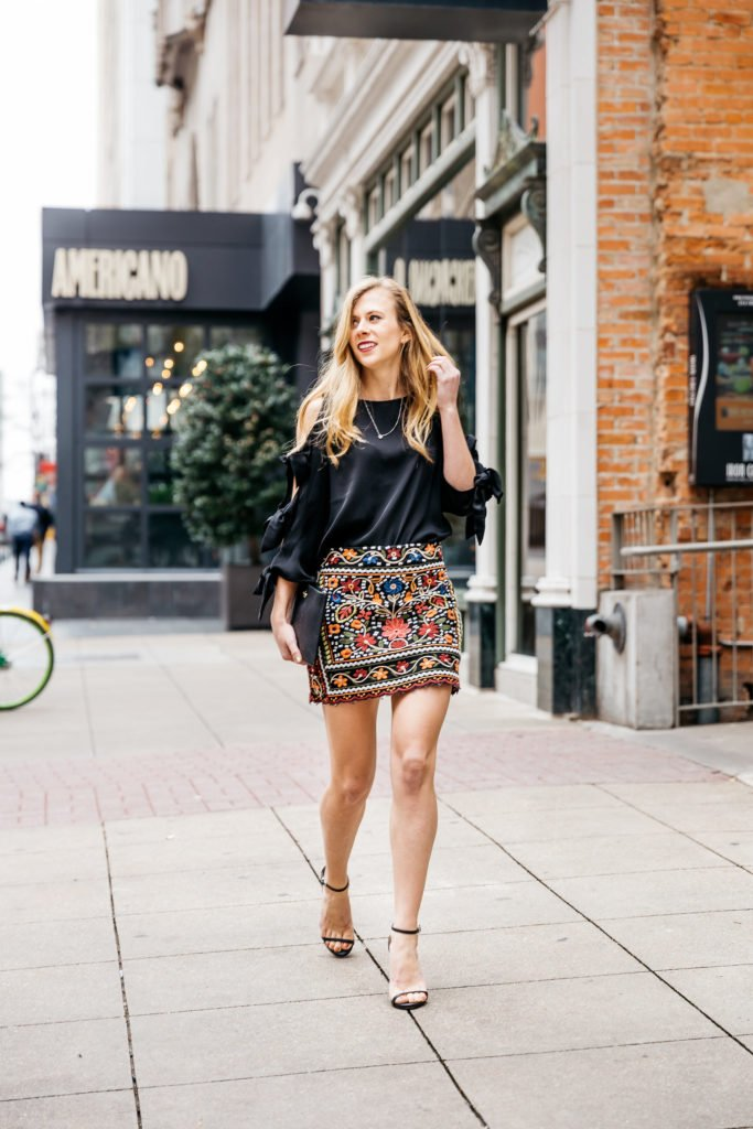 Embroidered Mini skirt, tie sleeve top, and black Kate Spade clutch | Going out outfits | Running in Heels