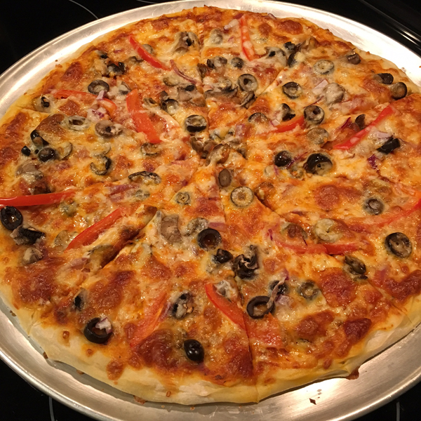 Hand tossed veggie pizza is delicious in a restaurant and even better when made at home. -Running on Happy