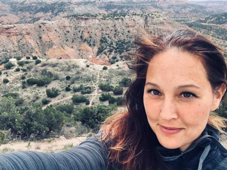 Hi, I'm Coach Amie, a pro distance running and weight loss coach dedicated to helping you run better and be healthier! This is on the rim of Palo Duro Canyon, headed to run the trails - a vacation you could be taking someday...