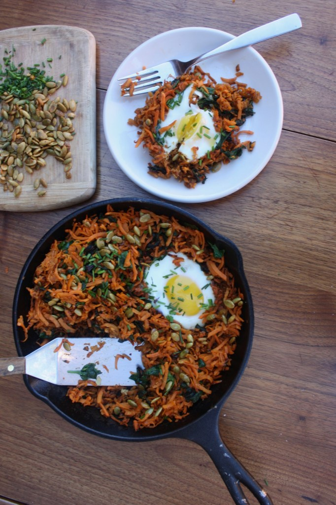The Ultimate Energizing Breakfast. Baked Eggs with Sweet Potato Hash and Spiced Pumpkin Seeds