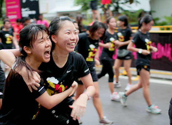 Best friends cross the finishing line with laughters and smiles