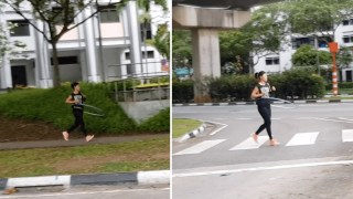Woman Runner at Sengkang Jogs While Keeps Hula Hoop Spinning
