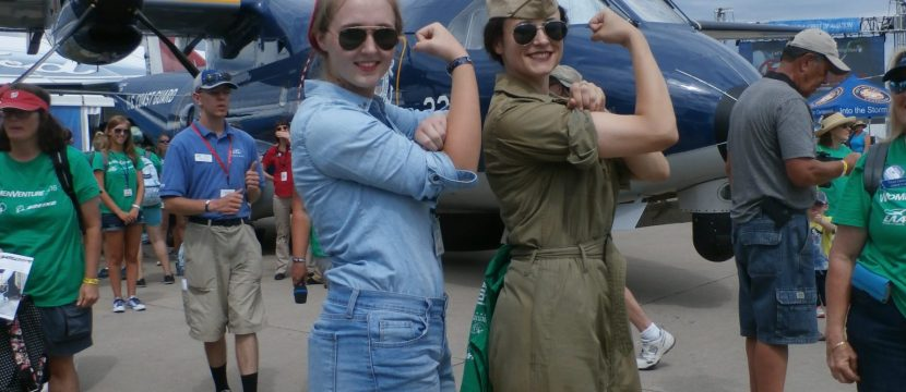 Two EAA AirVenture attendees channel Rosie the Riveter and the WASPs. Image: Kathryn Creedy