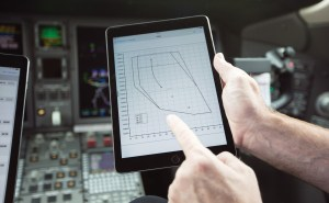 In this image, a pilot is using APG's iPreFlight iPad app to calculate his aircraft's runway performance for a flight. Image: