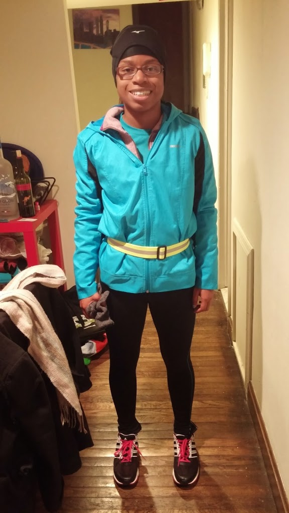 Me heading out on a night run last winter - note the bright clothes and reflective belt!