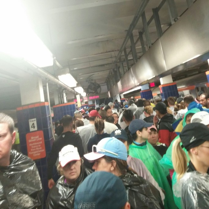 People waiting in the subway before the race