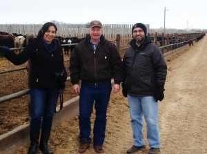 Beef Researcher Mentorship program participants, Dr. Claudia Narvaez Bravo (left) and Dr. Argenis Rodas-Gonzalez (right) tour Martin Unrau's (middle) feedlot with one of Claudia's mentors, Tom Teichroeb.