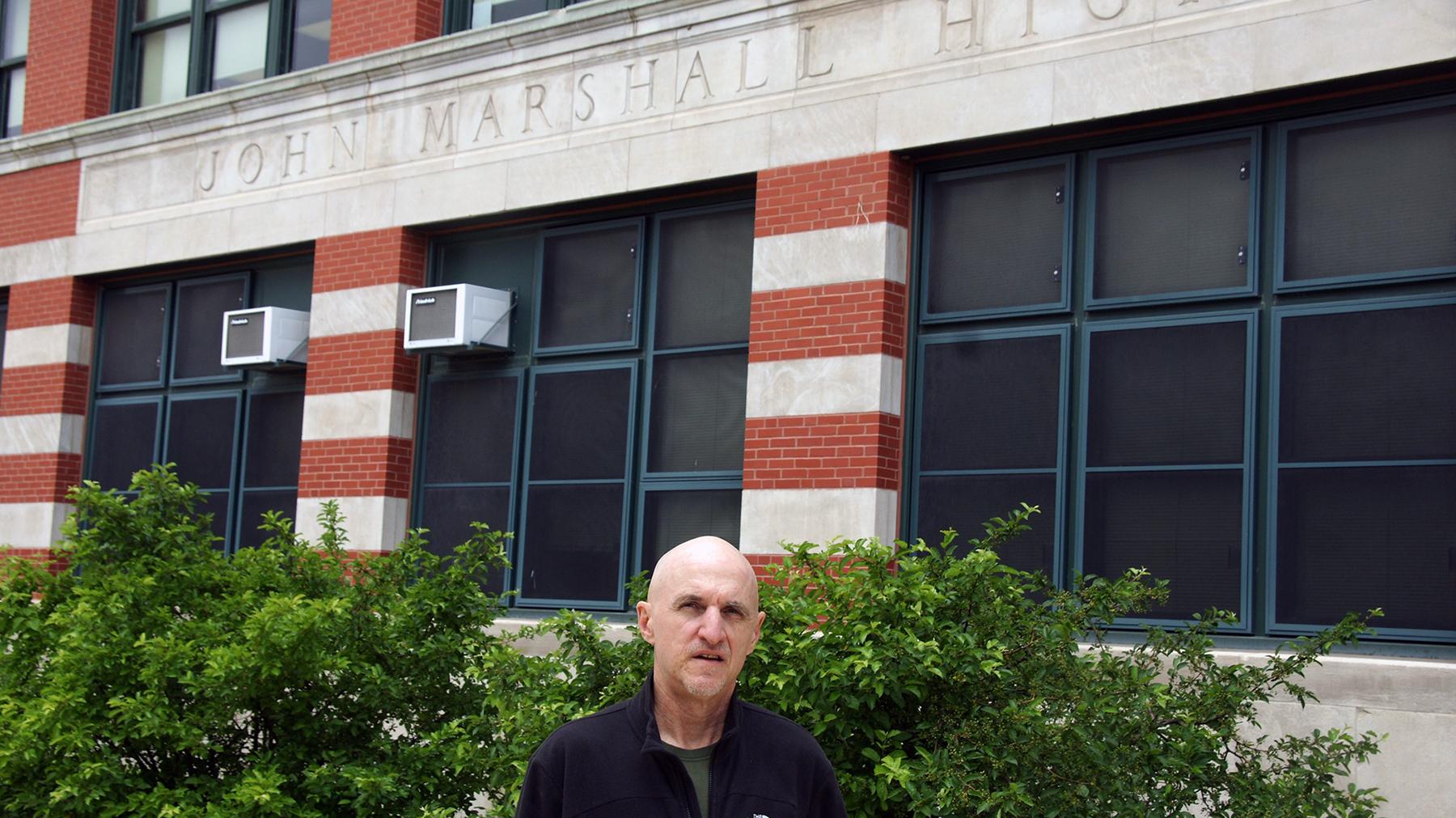 Rus Bradburd in front of John Marshall High