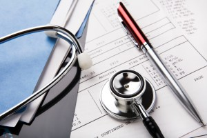 Orange County Auto Accident Attorney - stethoscope and medical file