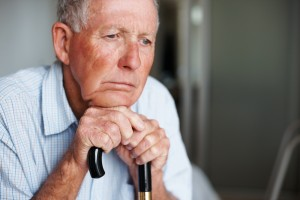 elderly man looking out window Orange County Elder Abuse Attorney