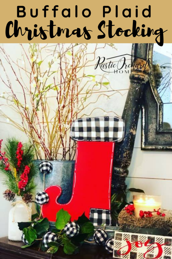 This DIY Christmas Stocking craft is so simple! Create the perfect freehand buffalo plaid door hanger for your home or make these as handmade Christmas gifts for all of your friends! #rustictorchardhome #christmasdecor #christmascraft #buffaloplaid #DIYchristmashomedecor