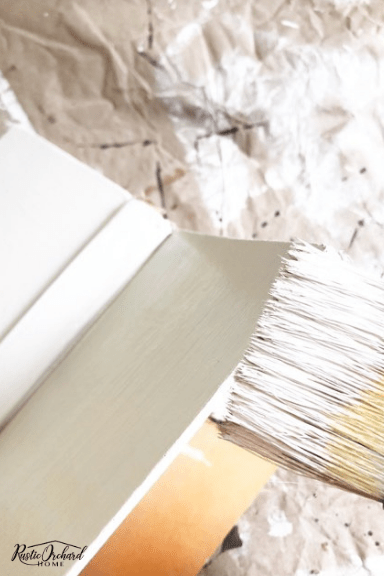 Upcyled Books that have been painted and embellished make great budget friendly home decor! #rusticorchardhome #upcycledbooks #paintedbooks #diyhomedecor #upcycledhomedecor