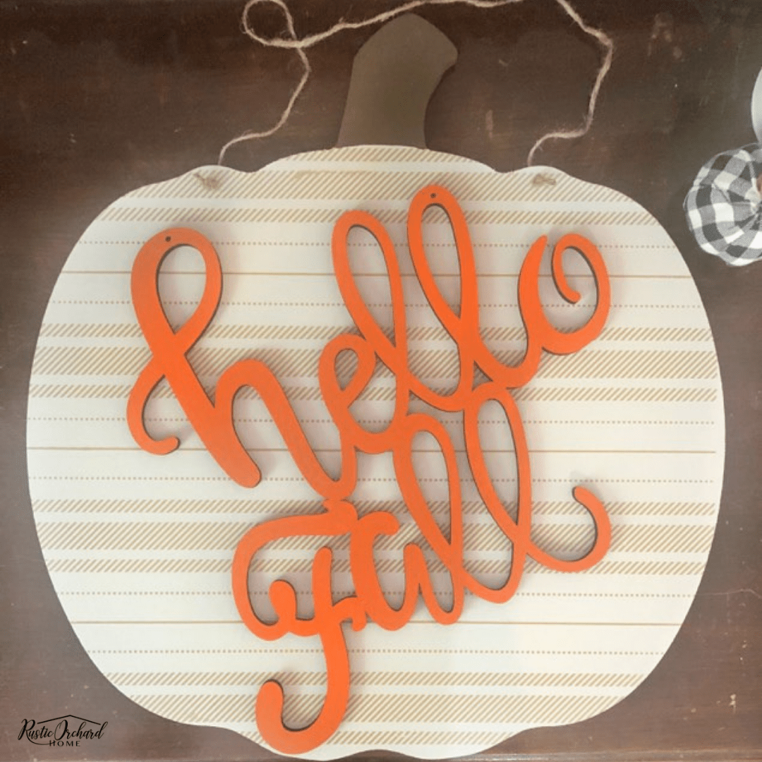 Learn how to make your own Hello Fall Pumpkin Door Hanger with this super easy Fall DIY home decor tutorial. #rusticorchardhome #hellofall #pumpkindoorhanger #diyfallhomedecor #fallfarmhomediy