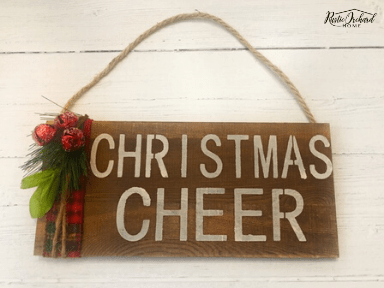 Learn to add Christmas Stencils to wooden signs for the perfect farmhouse decor or easy handmade gifts. #rusticorchardhome #christmasdiy #farmhousechristmas #christmascraft #handmadechristmas