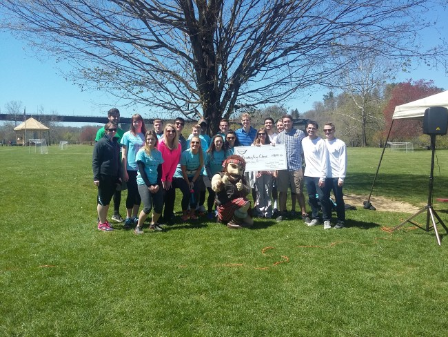 Pre-Dental Club, Janine Underwood, race winners, and the Highlander after the race. The event raised over 4000 dollars for the clinic.