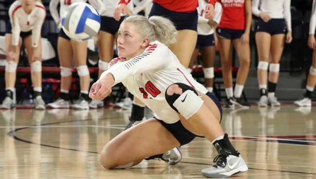 Maddie Palmer executes a dig in the Big South finals. Courtesy of Radford Athletics