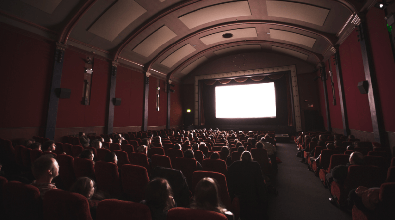 Movie theatre filled with people