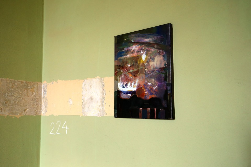 mixed media artwork in exhibition, green wall