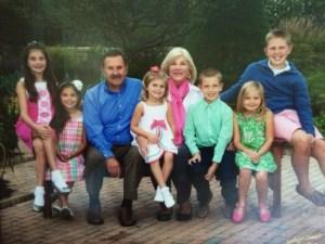 Jean & Juris with their grandchildren