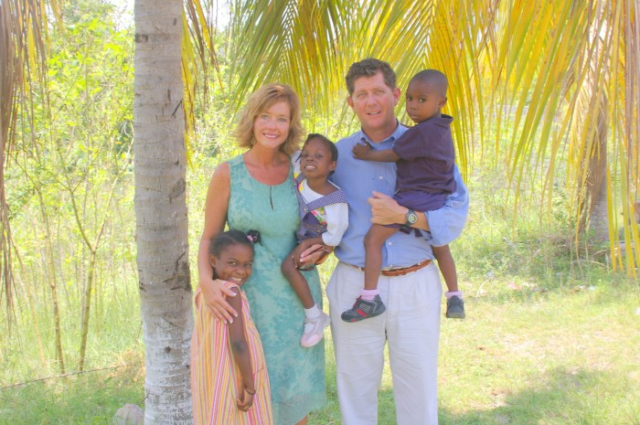 Mike and Beth love on a few orphans in Haiti, 2010.