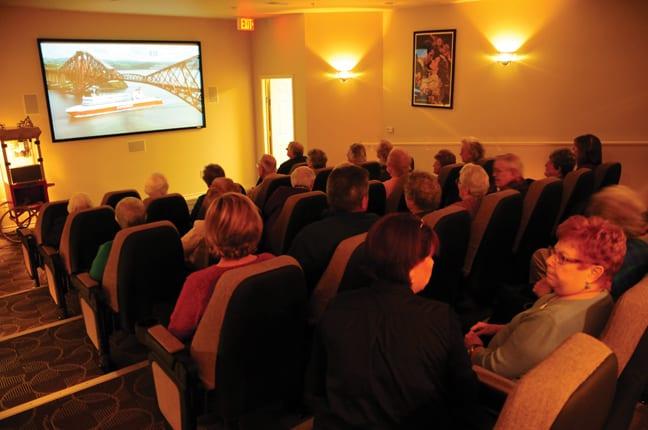People watching movie in senior living community media room
