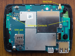 Figure 4: 6620 internals showing SIM slot, spring antenna contacts, and test port.
