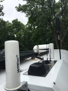 Antennas are sprouting on our roof like barnacles. From left to right: BoatAnt-1, MobileMark 4-in-1, weBoost MiniMag, Max-Amp Antenna, weBoost MiniMag #2, BoatAnt-2 MIMO, and weBoost Trucker 4G.