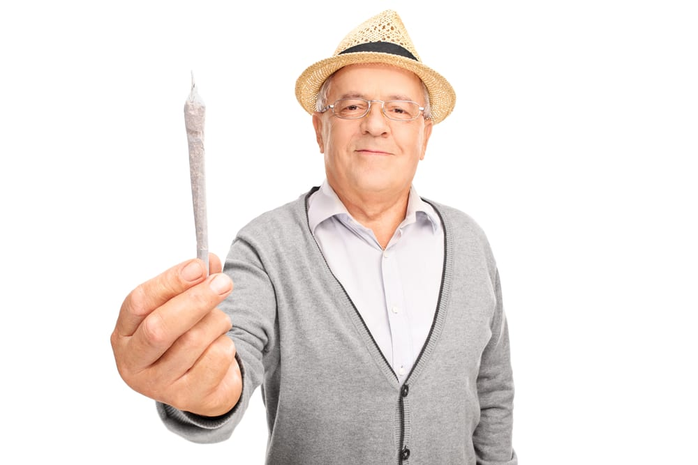 Grandpa offering a joint to the camera