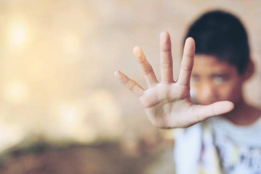 Boy Holding Hand out in stop gesture, tics
