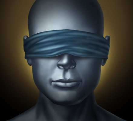 Blindfolded human head suggestive of double blind placebo tests