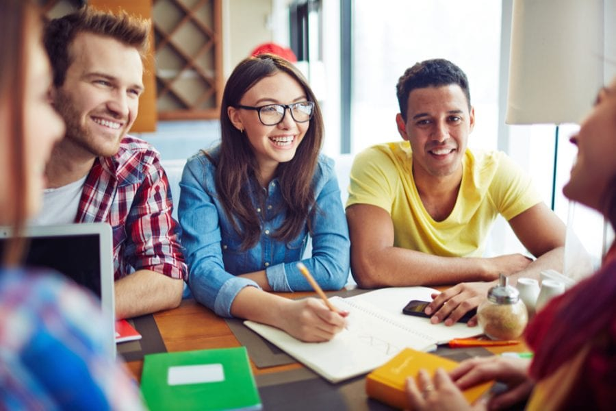 Happy Teens in Cafe