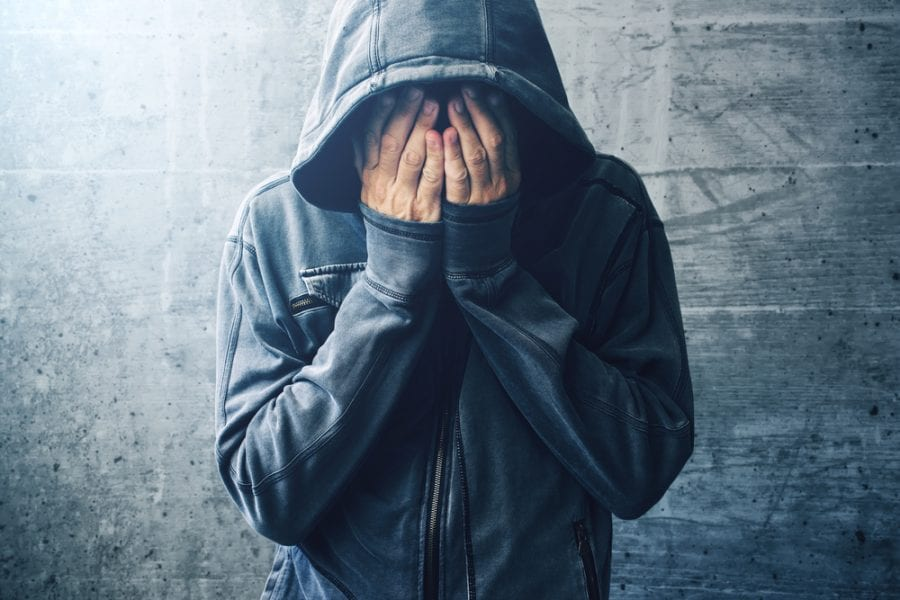 Addicted Man covering face