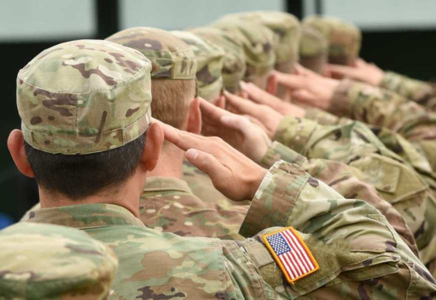 Close up of line of American Soldiers saluting, VA