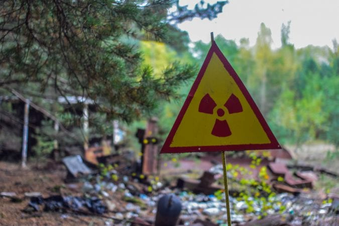 Radioactive sign in front of abandoned street