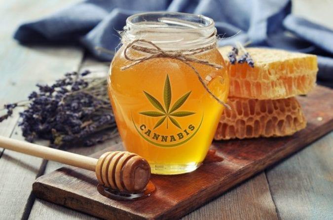 Cannabis honey next to honey comb