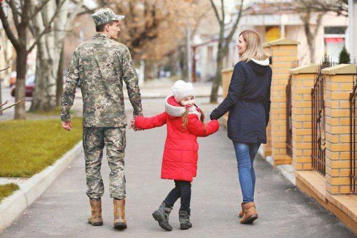 vet walking with family