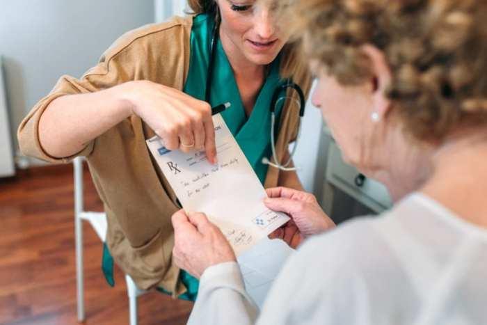Illinois Opioid Swap elderly woman getting prescription from doc