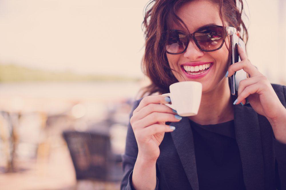 smart looking woman on phone