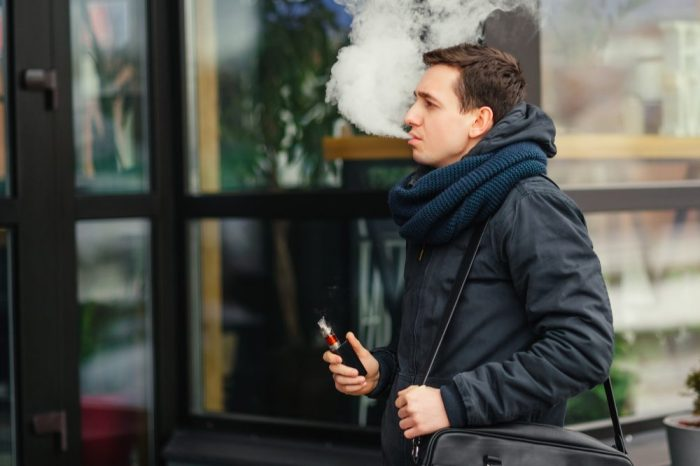 man on street representing vaping second hand smoke