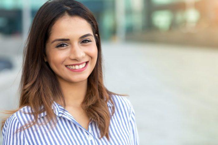 happy woman smiles at camera