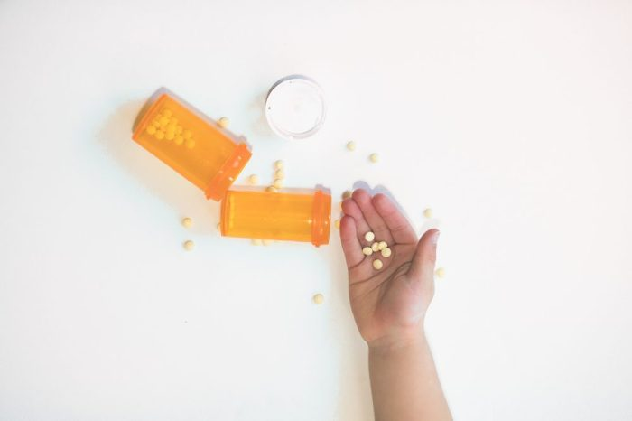 holding pills with spilled bottle