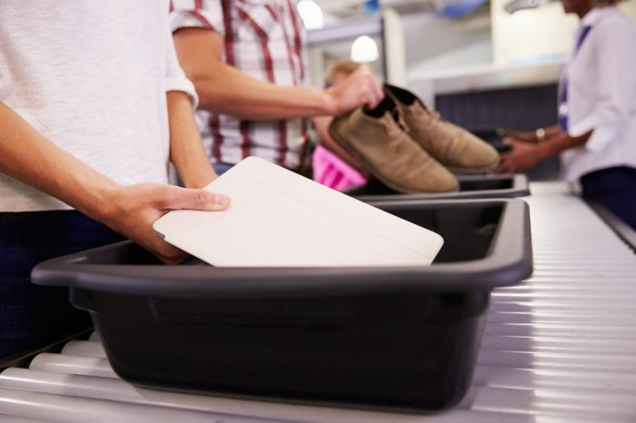 airport x-ray scanning bins, lookign for those traveling with cannabis